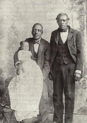 Seated is Jerome Snowden holding his daughter, Emma age 2, & his father Benj. F. Snowden, cir. 1872